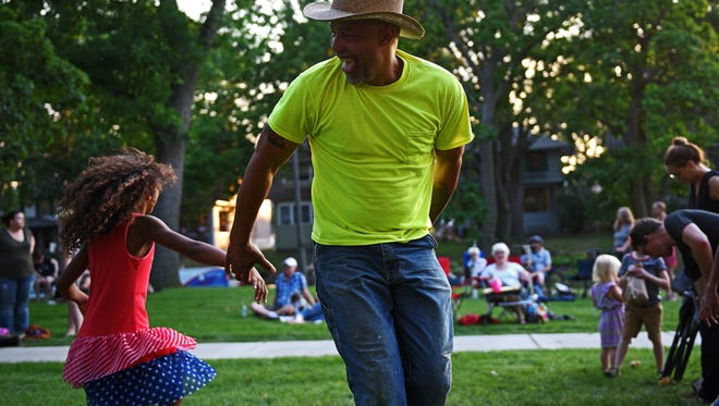 George Hamilton, of Sioux Falls, dances with Delia Colon, 10, also of Sioux Falls, during a National Night Out event Tuesday, Aug. 2, 2016, at Lyon Park in Sioux Falls.