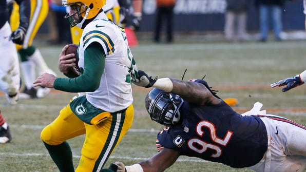 "FILE - In this Sunday, Dec. 18, 2016, file photo, Green Bay Packers quarterback Aaron Rodgers is sacked by Chicago Bears linebacker Pernell McPhee (92) during the second half of an NFL football game, in Chicago. The Bears finished their worst season in decades last in the NFC North with a 3-13 record after being shredded by injuries, suspensions and poor play overall. ""It was all bad,"" McPhee said. ""I'm happy we're out of 2016."" (AP Photo/Charles Rex Arbogast, File)"