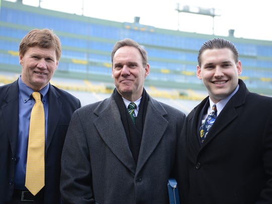Green Bay Packers president and CEO Mark Murphy poses with Steve Shumer, the 17th member of the Green Bay Packers Fan Hall of Fame, and his son, Adam, inside Lambeau Field.