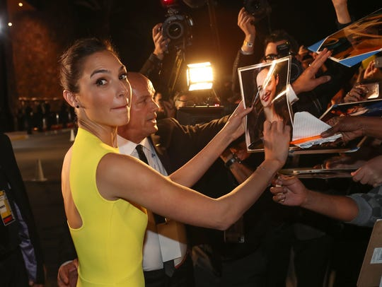 Gal Gadot autographs posters at the 2018 Palm Springs International Film Festival Awards Gala in Palm Springs.