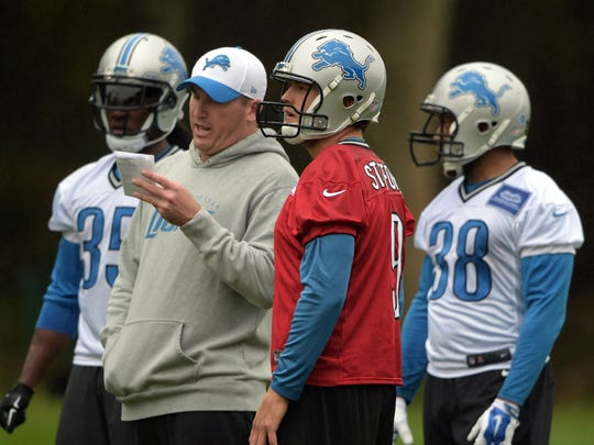 Oct 29, 2015; Chandler's Cross, United Kingdom; Detroit Lions offensive coordinator Jim Bob Cooter (center) talks with quarterback Matthew Stafford (9), tight end Eric Ebron (85) and running back George Winn (38) during practice at The Grove in preparation of the NFL International Series game against the Kansas City Chiefs.
