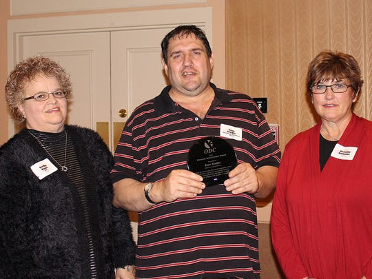 Sandy Ewan, ODC employment coordinator, from left, with 2015 Personal Achievement Award recipient Alan Steder and his sister, Annette.