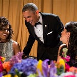 President Barack Obama shares a laugh with first lady Michelle Obama and comedian Cecily Strong during the White House Correspondents' Dinner on Saturday.