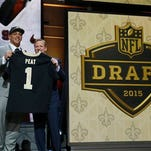 Stanford offensive lineman Andrus Peat poses for photos with NFL commissioner Roger Goodell after being selected by the New Orleans Saints as the 13th pick in the first round of the 2015 NFL Draft.