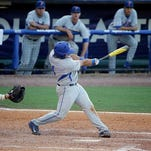 Florida's Mike Rivera, front right, hits a solo home run during the ninth inning of a Southeastern Conference college baseball tournament game against LSU, Saturday, May 23, 2015, in Hoover, Ala. Florida won 2-1. (AP Photo/Brynn Anderson)