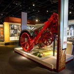 In this photo taken June 16, 2015, a gas powered Fordson tractor from the 1920s is displayed as part of U.S. agriculture business history at the American Enterprise exhibit at the Smithsonian's National Museum of American History in Washington. A wide range of innovations from Eli Whitneys cotton gin to the early Google servers will help tell the story of American business history for the first time at the Smithsonian. The Smithsonians National Museum of American History will open its new innovation wing on July 1. It will galleries featuring U.S. inventions, money and hands-on activities. A major exhibition about American Enterprise will trace the interaction of capitalism and democracy since the mid-1700s.