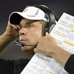 New Orleans Saints head coach Sean Payton watches the action from the sidelines during the first half of an NFL preseason football game against the Baltimore Ravens in Baltimore on Thursday.