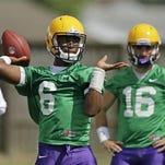 LSU quarterback Brandon Harris (6) works out during practice in Baton Rouge. Behind is quarterback Brad Kragthorpe (16).
