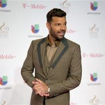 "FILE - In a Thursday, Feb. 19, 2015 file photo, Ricky Martin walks the red carpet before the Premio Lo Nuestro Latin Music Awards show in Miami. Martin begins the US-leg of his ""One World Tour"" on Tuesday, Sept. 15, 2015, while evoking his days with Menudo as a judge and executive producer of Univision?s new reality ""La Banda"". (AP Photo/J Pat Carter, File)"