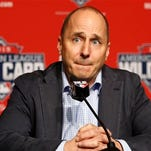 New York Yankees general manager Brian Cashman addresses the media about New York Yankees starting pitcher CC Sabathia, who told the club he is checking himself into an alcohol rehabilitation center and therefore will miss the playoffs, before a workout day Monday, Oct. 5, 2015, for Tuesday's American League Wild Card game at Yankee Stadium in New York. (AP Photo/Kathy Willens)