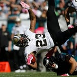 New Orleans Saints' Marcus Murphy is tackled by Philadelphia Eagles' Chris Maragos during the first half of an NFL football game, Sunday.