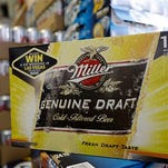 In this Monday, Jan. 28, 2013 file photo, Miller Genuine Draft beer is for sale on a shelf in the aisles of Elite Beverages in Indianapolis. British-based brewer SABMiller accepted in principle  a 69 billion pound ($106 billion) takeover offer from Anheuser Busch InBev on Tuesday, Oct. 13, 2015 that will create the world's biggest beer company and bring together top U.S. brands Budweiser and Miller Genuine Draft. (AP Photo/Michael Conroy, File)