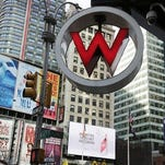 FILE - In this Wednesday, July 31, 2013, file photo, the logo for the W Hotel, owned by Starwood Hotels & Resorts Worldwide, is seen in New York's Times Square. Marriott International announced Monday, Nov. 16, 2015, it is buying rival hotel chain Starwood for $12.2 billion in a deal that will secure its position as the world's largest hotelier.