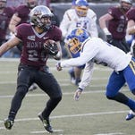 Montana running back John Nguyen (20) against South Dakota State during the second half of a first round game in the NCAA college Football Championship Subdivision playoff, Saturday, Nov. 28, 2015, in Missoula, Mont. Montana won 24-17. (AP Photo/Patrick Record)