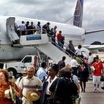 FILE - In this Nov. 1, 2001, file photo, the first passengers of the first flight of Continental Airlines from Miami Florida, arrives at the Jose Marti Airport of Havana, Cuba. The United States and Cuba have reached an understanding on restoring regularly scheduled commercial flights, Cuban and American officials said Wednesday, Dec. 16, 2016 on the eve of the anniversary of detente between the Cold War foes. (AP Photo/Jose Goitia, File)