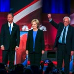 Democratic presidential candidate, former Maryland Gov. Martin O'Malley , left, Democratic presidential candidate, Hillary Clinton and Democratic presidential candidate, Sen. Bernie Sanders, I-Vt, stand together before the start of the NBC, YouTube Democratic presidential debate at the Gaillard Center, Sunday, Jan. 17, 2016, in Charleston, S.C.