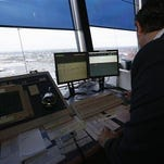 FILE - In this May 21, 2015 file photo, the Newark Liberty International Airport the air traffic control tower in Newark, N.J. A government watchdog says there are too few fully qualified controllers at more than a dozen air traffic facilities stretching from Atlanta to Anchorage. A report released Tuesday, Jan. 26, 2016, by the Transportation Department's inspector general says the 13 airport towers, approach control facilities and en route centers have fewer fully trained controllers than the minimum number established by the Federal Aviation Administration.