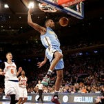 Denver Nuggets' Will Barton, center, dunks the ball during the first half of an NBA basketball game against the New York Knicks, Sunday, Feb. 7, 2016, in New York. (AP Photo/Seth Wenig)