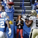New Orleans Saints tight end Benjamin Watson (82) makes a catch on a fake field goal in front of Indianapolis Colts inside linebacker D'Qwell Jackson (52) in a game last October.