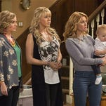 """This image released by Netflix shows, from left, Andrea Barber, Jodie Sweetin, and Candace Cameron Bure in a scene from, """"Fuller House,"""" streaming on Netflix beginning on Friday, Feb. 26."""