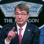 FILE - In this Dec. 3, 2015, file photo, Defense Secretary Ash Carter gestures during a news conference at the Pentagon (AP Photo/Cliff Owen, File)