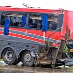 A damaged OGA Charters bus is hauled away after a fatal rollover on Saturday, May 14, 2016, south of the Dimmit-Webb County line on U.S. 83 North in Texas. (Laredo Texas, Nuevo Laredo Mexico out, Mandatory credit Danny Zaragoza | Laredo Morning Times.)