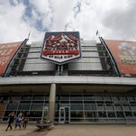 In this Thursday, May 26, 2016, photograph, shoppers leave the team store below the sign for Sports Authority Field at Mile High on the south end of the stadium that is the home of the NFL football team Denver Broncos in Denver. The demise of Sports Authority has reignited a fight in Colorado over the future of the Denver Broncos' stadium, a place long tied to the city's identity. Sports Authority hopes to sell off its naming rights to the stadium, but the Broncos and officials appointed to run the taxpayer-built stadium are fighting that in bankruptcy court.   (AP Photo/David Zalubowski)