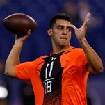 Former Oregon quarterback Marcus Mariota was named college football player of the year by the Maxwell Football Club.
