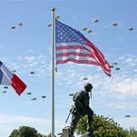 Paratroopers are dropped near the Normandy village of Sainte Mere Eglise, western France, during a mass air drop June 8, 2014, as part of commemorations of the 70 anniversary of the D-Day landing.