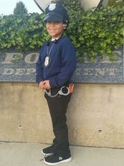 Orion Clark poses in one of his five or six police