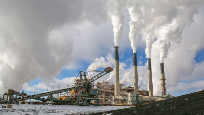 Large stacks fill the sky with steam at PacifiCorp's Jim Bridger coal plant in southwestern Wyoming on Dec. 7, 2016.