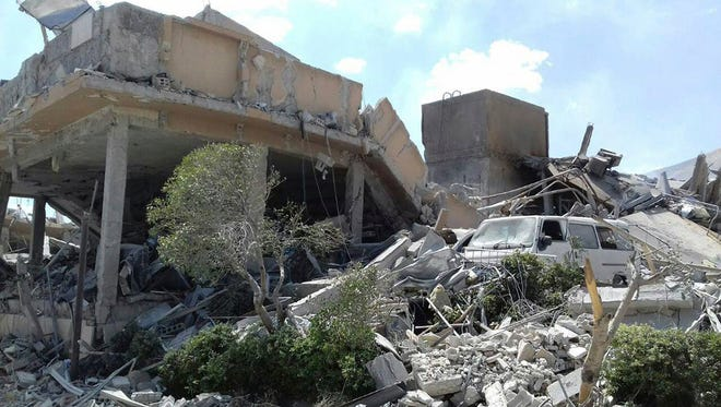 In this photo released by the Syrian official news agency SANA, shows the damage of the Syrian Scientific Research Center which was attacked by U.S., British and French military strikes to punish President Bashar Assad for suspected chemical attack against civilians, in Barzeh, near Damascus, Syria, Saturday, April 14.