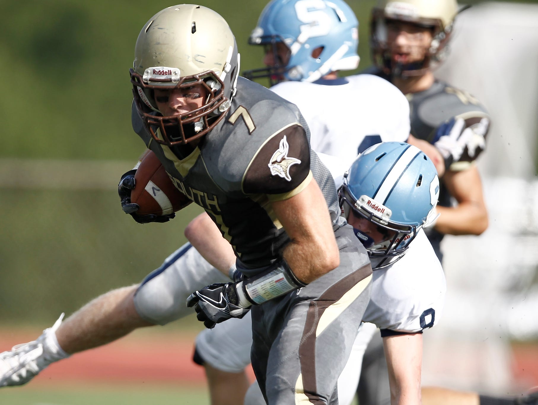 Clarkstown South's Sam Mistretta (7) works to break a tackle during their 30 - 0 win over Suffern at Clarkstown South High School on Saturday, September 17, 2016.