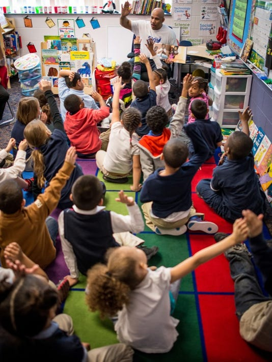 Students at Ferguson K-8 School in York City listen to a story. Schools in the York City School District could be taken over by charter operators starting in 2015-16.