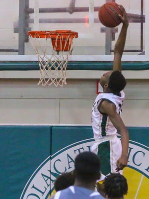 Catholic's DJ McKenzie (24) tries to throw down a dunk against Foley in their quarterfinal game during the 6th annual Crusader Classic at Catholic High School on Wednesday, December 27, 2017. Catholic won 70-48 and will face West Florida in the semifinals on Thursday.