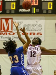 PHS' Akira Jenkins (12) goes up against Pine Forest's Danielle Luckey (23) during the opening tipoff at Pensacola High School on Friday, January 19, 2018. PHS won 72-44.