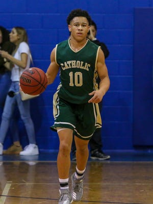 Catholic's Demarius Nickerson (10) dribbles up the court against Washington at Washington High School on Friday, January 26, 2018.