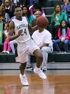 Pensacola Catholic senior guard DJ McKenzie led his team in scoring with 20 points in Friday night's win over Navarre.