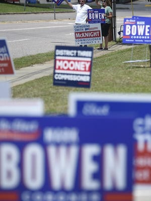 People campaign for coroner Mark Bowen at the Julian Smith Casino during election day in Augusta, Ga., Tuesday afternoon June 9, 2020.
