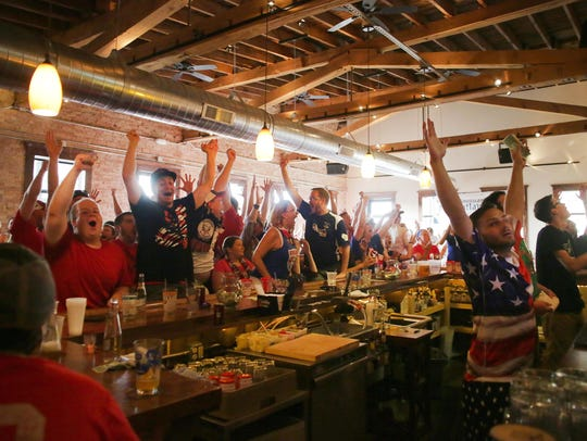 Soccer fans react to the U.S. team's fourth goal during