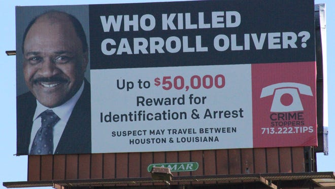 A billboard on La. Highway 1 between Alexandria and Marksville seeks information on possible suspects in a Houston homicide case.