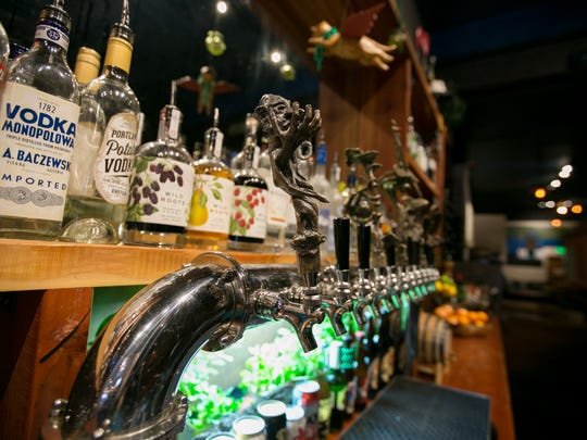 The bar is seen at Taproot Lounge & Cafe, which features