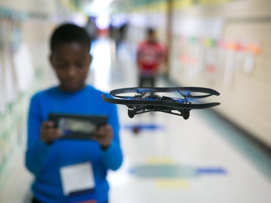 Justin Dorce, 10, a fifth-grade student in Lisa Mim's class at Pleasantville Elementary, flies an aerial drone in the hallway of the school.