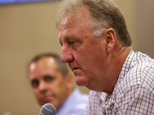 Indiana Pacers President of Basketball Operations Larry Bird, right,  and head coach Frank Vogel talk about the injury to player Paul George during a press conference in Indianapolis, Tuesday, Aug. 12, 2014. (AP Photo/Michael Conroy)