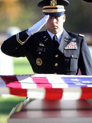 An Indiana National Guard member saluted the coffin of Spc. Jacob Sexton at Beech Grove Cemetery during his funeral in 2009. Sexton shot himself in a Muncie theater while he was home on a 15-day leave.