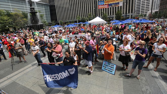 Hundreds of people rally for gay marriage on Fountain Square in Cincinnati on Wednesday, Aug. 6, 2014 as lawyers from four states argued before an appellate panel at the U.S. 6th Circuit Court of Appeals weighing whether same-sex marriage bans are unconstitutional.