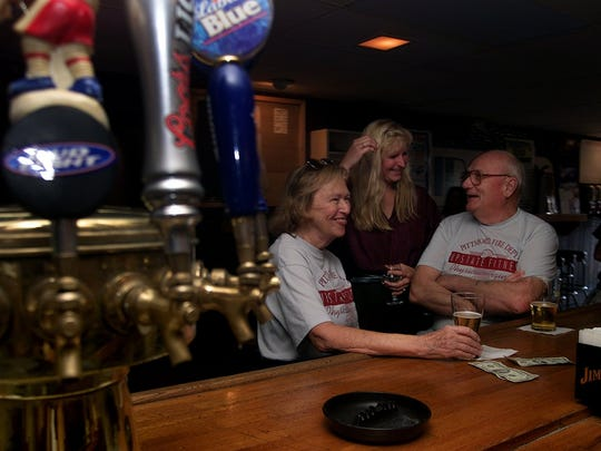 """In 2001, Kelley Coady of Pittsford, center, shares a laugh with Manny and Norma Remmel. """"Thirsty's is just like Cheers, everybody knows your name,"""" Coady said at the time."""
