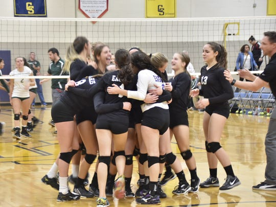PCA Eagles players celebrate during Tuesday's Class D quarterfinal match win.