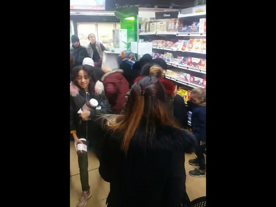 In this image taken from video a customer carries away pots of Nutella, as others congregate around a display of the product in a supermarket in Toulon southern France on Jan. 25.