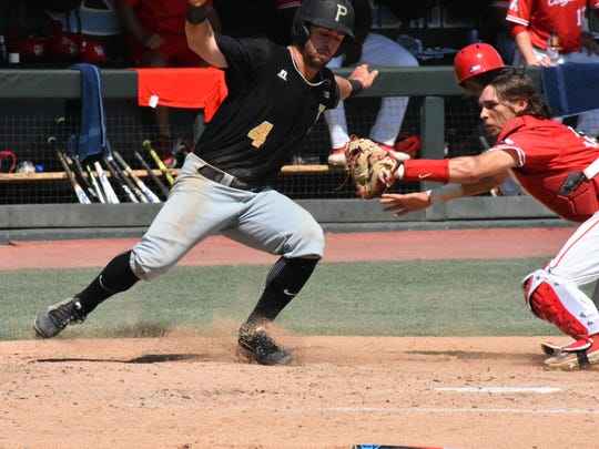 Purdue's Skyler Hunter is out at home trying to score on Evan Kennedy's seventh inning single.